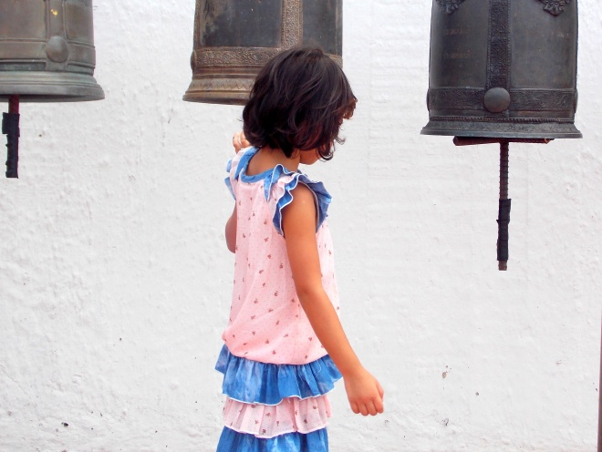Little Girl ringing the bells