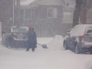 Neighbor Shoveling Snow
