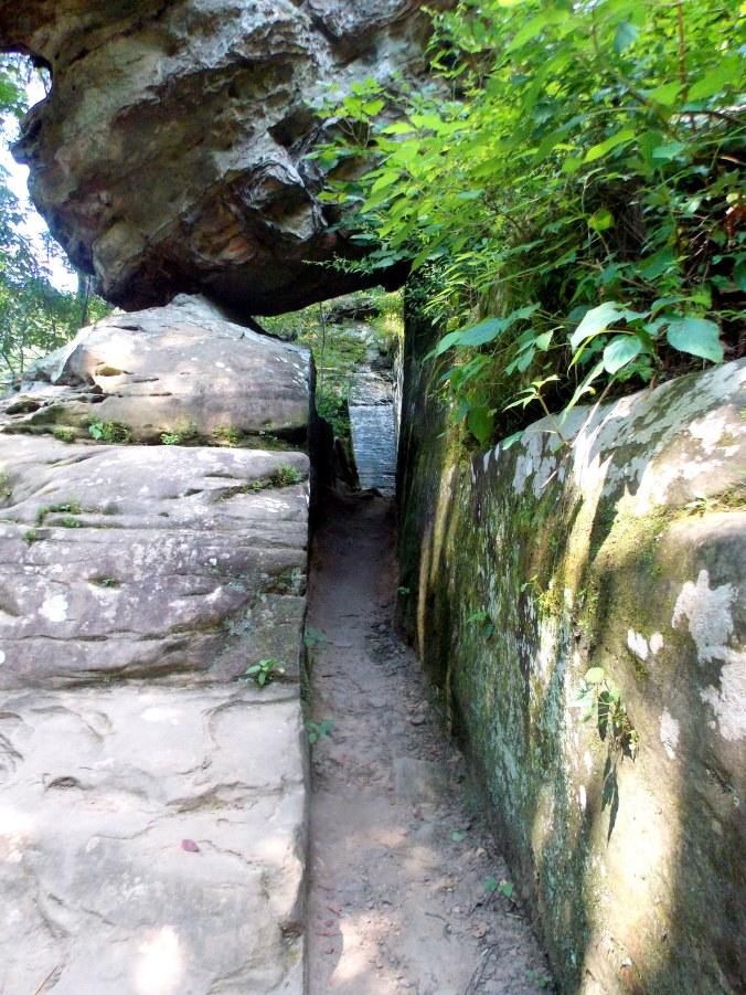 Go under the boulder